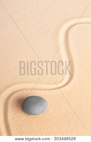 Zen meditation stone for concentration on the healing of mind body and soul. Contact with your soul and spirit through focusing and relaxation.  stock photo