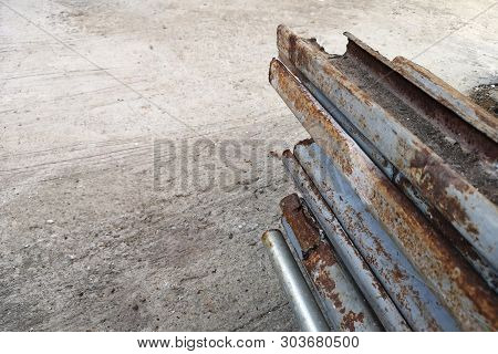 Corrosion and corrosion of steel posts ,cement wall background and empty with copy space for text . stock photo