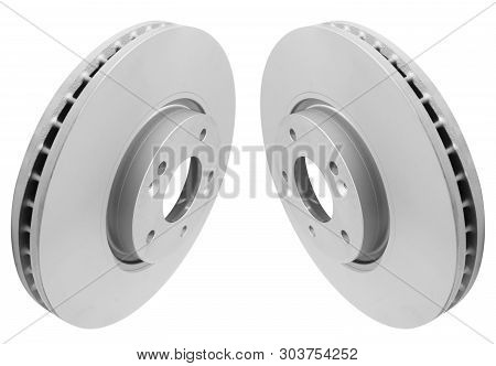 Two Car Brake disc isolated on white background. Auto parts. Brake disc rotor isolated on white. Braking disk. Car part. Car detailing. Spare parts. Black and white stock photo