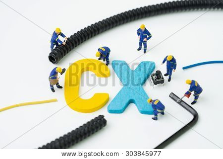 CX, Customer Experience concept, miniature figure worker building alphabet CX at the center, important of customer centric experience design in recent world business, product and service. stock photo