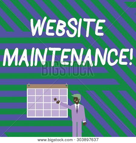 Handwriting text writing Website Maintenance. Concept meaning act of regularly checking your website for issues Businessman Smiling and Pointing to Colorful Calendar with Star Hang on Wall. stock photo