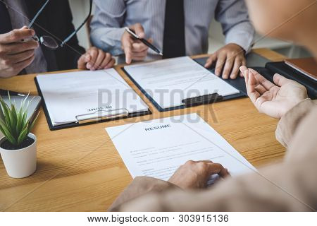 Business woman explaining about his profile to two selection committee manager sitting in during job Interview, interview the job and hiring. stock photo