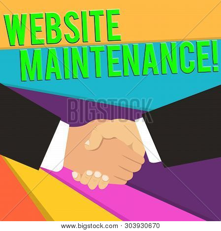 Handwriting text Website Maintenance. Concept meaning act of regularly checking your website for issues Hand Shake Multiracial Male Business Partners Colleagues Formal Black Suits. stock photo