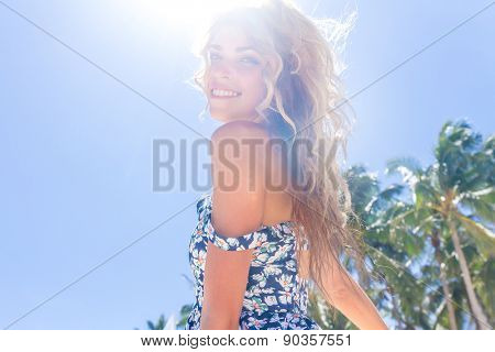 young happy girl with flower bouquet on tropical sea and beach background, smiling happy girl outdoo