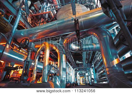 Equipment cables and piping as found inside of a modern industrial power plant stock photo
