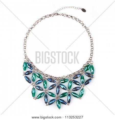 Silver necklace with blue and green rhinestones, isolated on white. A rhinestone or diamante is a diamond simulant made from rock crystal, glass or acrylic stock photo