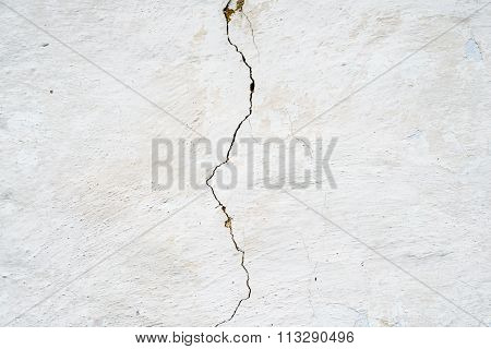 Cracked whitewashed wall of the old wattle and daub house. stock photo
