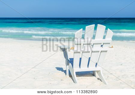 Tropical Resort View With Beach Chair Over Turquoise Sea At Exotic Sandy Beach