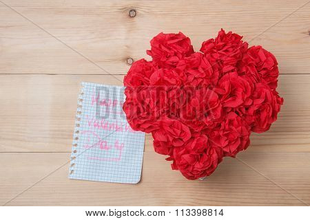 Handmaid flowers in box with happy valentines day card on brown wooden background stock photo