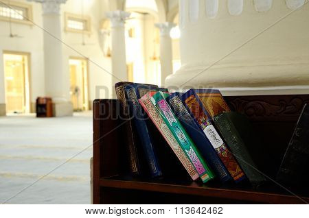 JOHOR, MALAYSIA - JANUARY, 2014: Quran on wooden rack in The Sultan Abu Bakar State Mosque in Johor Bharu, Malaysia stock photo