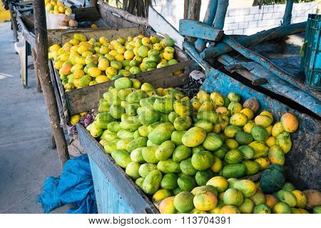 Open air mango market in the village in Bani, Dominican Republic ** Note: Soft Focus at 100%, best at smaller sizes stock photo