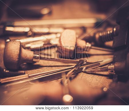 Different goldsmiths tools on the goldsmith workplace.  stock photo