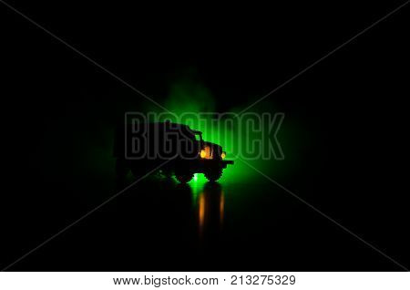 Truck in the conflict zone. The war in the countryside. War vehicle silhouette at night. Battle scene. War concept stock photo