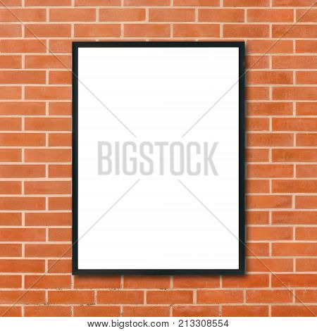Mock up blank poster picture frame hanging on red brick wall background in room - can be used mock up for montage products display and design key visual layout. Mock up poster in interior background. stock photo