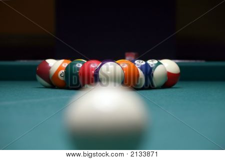 Billiard Balls in depth concentration on the main washed away perspective and on green table stock photo