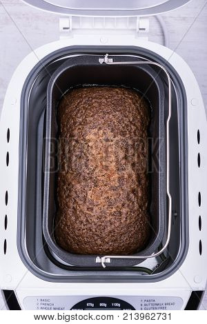 Homemade cocoa cake with walnuts and raisins baked in bread maker. stock photo