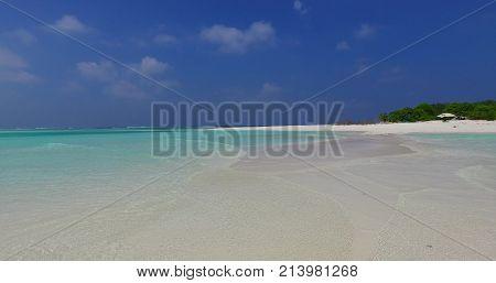 Maldives beautiful beach background white sandy tropical paradise island with blue sky sea water ocean 4k stock photo