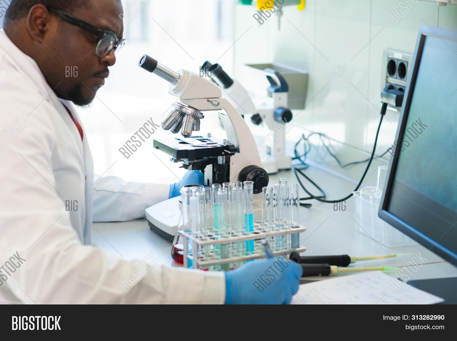 african american,analyzing,assistant,background,bacterium,bio,biochemistry,biology,biotechnology,black,chemical,chemistry,clinic,concept,day light,discovery,doctor,drugs,equipment,experiment,genetic,healthcare,innovate,lab,laboratory,man,medical,micro scope,microbiology,microscope,occupation,person,pharmaceutical,professional,professor,research,results,sample,science,scientific,scientists,student,survey,technology,test tube,tools,vaccine,virus,window,worker