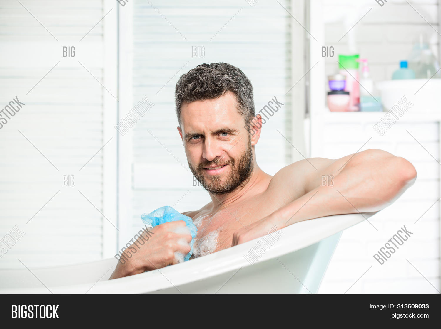 adult,athletic,bathing,bathroom,bathtub,body,can,care,clean,cleaning,concept,confidence,confident,freshness,gel,handsome,health,heart,hygiene,hygienic,improve,lotion,macho,man,masculine,naked,parts,peeling,personal,procedure,relaxation,relaxing,sexy,shower,skin,smile,sponge,take,total,use
