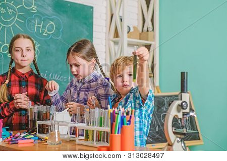 happy children use tube. back to school. biology education. Microscope. Biology school laboratory equipment. experimenting with chemicals or microscope at laboratory. Kind children doing school tasks stock photo