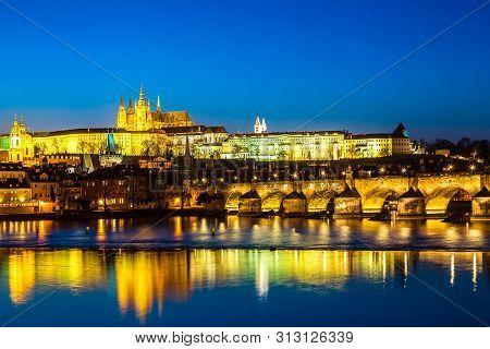 View of Charles Bridge, Prague Castle and Vltava river in Prague, Czech Republic during blue hour twilight sunset stock photo