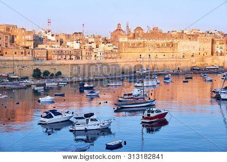View on Malta bay between Kalkara and Birgu with yahts at early morning stock photo