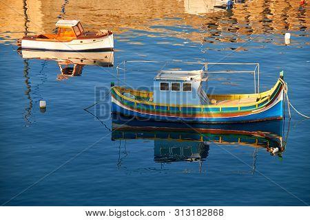 National maltese bout luzzu in malta bay between Birgu and Kalkara at morning time stock photo