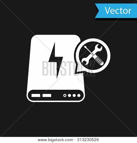 White Power bank with screwdriver and wrench icon isolated on black background. Adjusting, service, setting, maintenance, repair, fixing. Vector Illustration stock photo