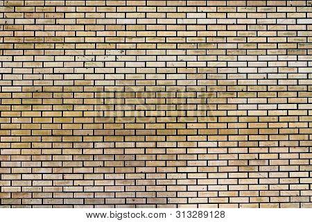 Beige brick wall abstract background. Blocks textured outdoor horizontal backdrop stock photo