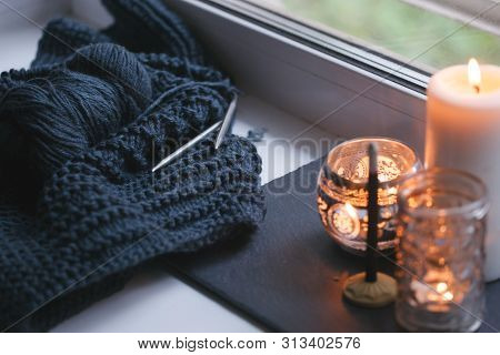 Candle and aroma stick on windowsill. Concept of relax, tranquil, peaceful, unplug, balanced time, Keep calm and take it easy, knit leisure, meditation zen background stock photo