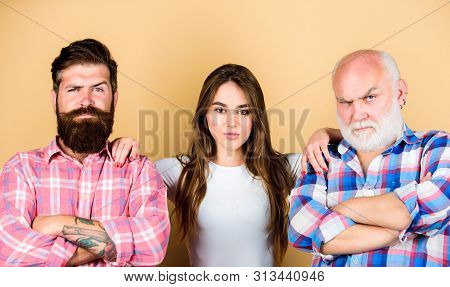 Choosing life partner. Girl pretty adorable woman prefer more experienced partner. Senior mature bearded men competitors. She likes mature partner. Men and female threesome. Relations group people stock photo
