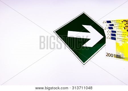 Arrow indicates money on a white background. Business and Finance. Banking industry. Isolated. Background image. Place for text. stock photo
