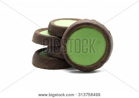Biscuits crunchy chocolate cookies with green tea flavoured topping choco plus. Isolated on white background. stock photo