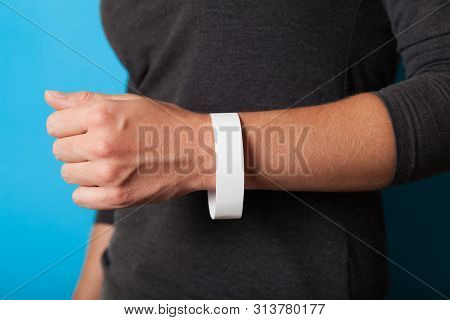 Concert paper bracelet mockup, event wristband. Arm activity accessory, adhesive, cheap. stock photo