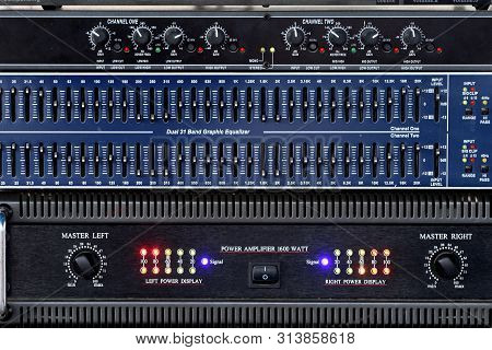closeup amplifier and equalizer electric panel have many button stock photo