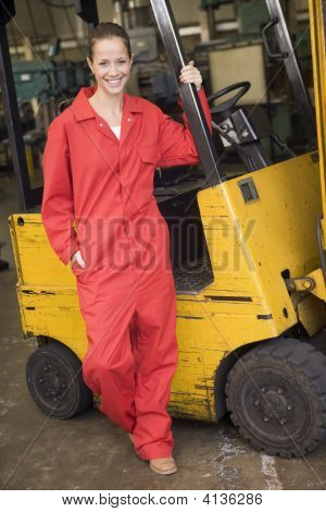 Two warehouse workers in forklift stock photo