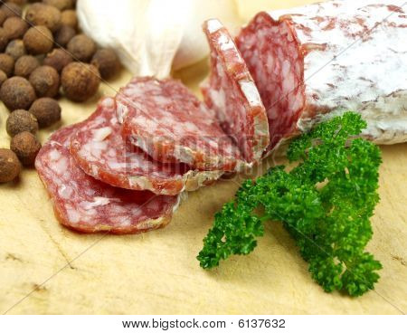 salami slices with a various types of spices stock photo