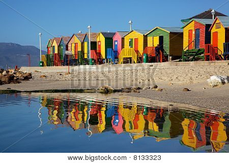 Brightly painted wooden bathing huts at St James Beach near Cape Town South Africa. stock photo