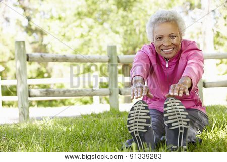 Senior African American Woman Exercising In Park