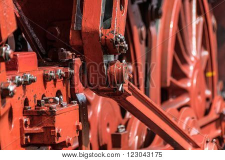 Gears and wheels of a steam engine stock photo