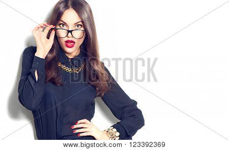 Beauty sexy fashion model girl wearing glasses, isolated on white background. Beautiful young brunet