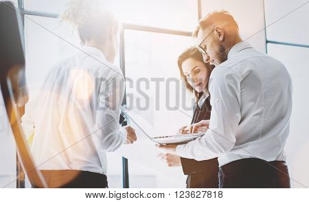 Business team work process. Photo professional crew working with new startup project. Project managers meeting. Analyze business plans laptop. Blurred background, film effect, bokeh.