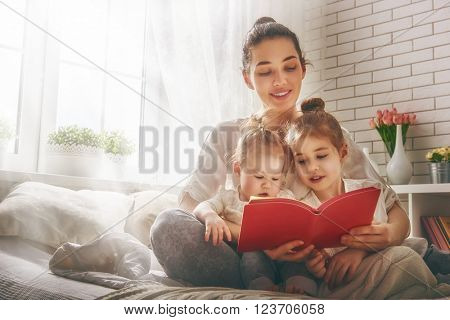 Funny family Mother and her child daughter girl with a paper accessories. Mother and daughter prepar