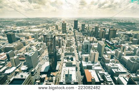 Skyline aerial view of skyscrapers in business district of Johannesburg - Architecture concept with modern buildings of skyline in South Africa biggest city with southafrican flag painted on walls stock photo
