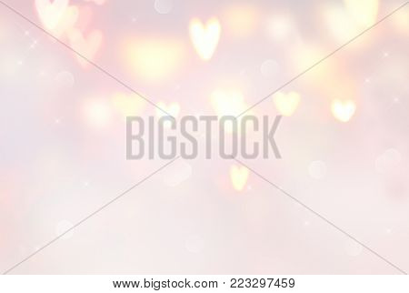 Holiday Valentine Hearts abstract glowing blurred background, bokeh. Defocused blinking heart shaped lights. St.Valentine's Day Wallpaper. Heart Holiday Backdrop, pastel colors, pink and beige stock photo