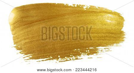 Gold color paint brush stroke. Big golden smear stain background on white backdrop. Abstract detaile