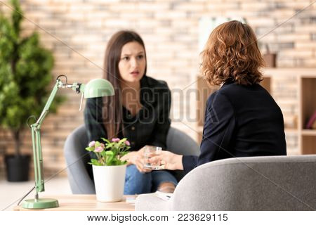 Female psychologist working with patient in office stock photo