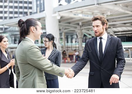 Businessman with agreement for working together for business project. Business handshake and business people concept. Business team handshake concept. stock photo