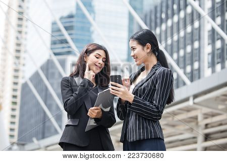 Business people looking to smartphone together. People wolking for business project with team. Business people  working concept. stock photo