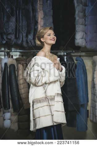 Shopping, seller, fashion model, customer. Fashion and beauty, winter, fur. Woman in fur coat, shopaholic. sensual woman in fur, luxury, moneybags, business. Purchase, shopping, business, moneybags. stock photo